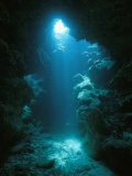A Beam of Sunlight Illuminates an Underwater Cave - Raul Touzon