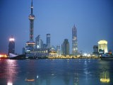 The Shanghai Skyline and Riverfront at Night - Raul Touzon