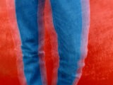 Vibrant Blue Jeans against a Red Background - Raymond Gehman