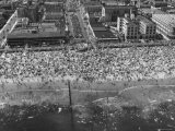 Aerial View of Crowds Enjoying a Hot 4th of July at Rockaway Beach - Sam Shere