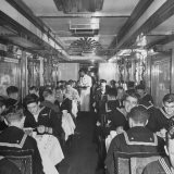 G.I. Personnel and Their Wives Eating in Dining Car While Civilians Will Have to Wait Until Later - Sam Shere