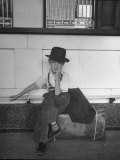 Little Boy Sitting on His Luggage While Waiting For the Train at the Denver Union Station - Sam Shere