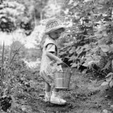 Little Girl with Hat and Pail Outdoors - Sandra Stambaugh