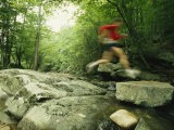 Panned View of Man Leaping over Rocky Stream on the Appalachian Trail - Skip Brown