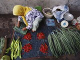 A Woman Sells Vegetables at an Open-Air Market in Malaysia - Steve Raymer