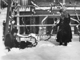 Young Lehman and a Girl Playing with a Sled in Deep Snow Outside 914 Lexington Ave, Brooklyn, Ny - Wallace G. Levison