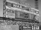 Large Scoreboard Towering over Fans Showing Baseball Scores from Around the League - Wallace Kirkland