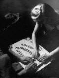 People Playing with a Ouija Board - Wallace Kirkland