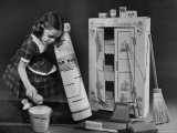 Little Girl with a Toy House Cleaning Kit - Walter Sanders