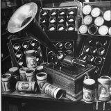 Phonograph Invented by Thomas A. Edison Sitting on Table with Boxes of Cylindrical Records - Walter Sanders