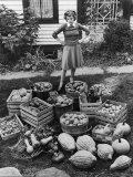 Woman Looking at Victory Garden Harvest Sitting on Lawn, Waiting to Be Stored Away for Winter - Walter Sanders