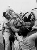 Crewman Lifting Injured Airman Kenneth Bratton Out of Turret of Tbf Aircraft on USS Saratoga - Wayne Miller