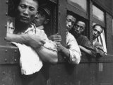 Discharged Japanese Soldiers Take Advantage of Free Transportation After WWII in Hiroshima, Japan - Wayne Miller