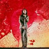 Rock Singer Jim Morrison of the Doors Posing in Front of Red and Yellow Psychedelic Backdrop - Yale Joel