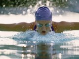 Young Woman Swimming the Butterfly Stroke