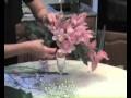 composition florale avec flutes de champagne